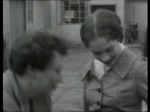 collection; 1955 collection; t041055 **poor sound quality** tx 4.10.55 mute/fx miss julie andrews arrives at london airport and is interviewed... - julie andrews stock videos & royalty-free footage