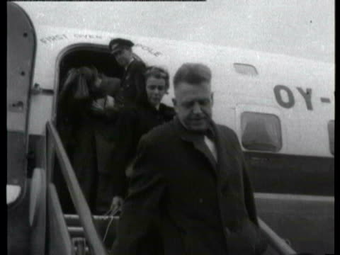 Collection 1955 Collection T221055 TX Dr Alfred Kinsey arrives at London Airport London London Airport Dr Alfred Kinsey down plane steps