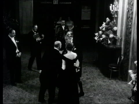 collection 1955 collection t281055 london covent garden illuminated building people in evening dress arriving for gala show clement attlee along with... - clarissa eden stock videos and b-roll footage