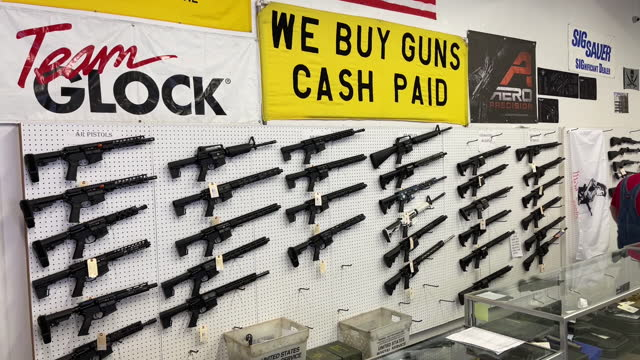 collection of ar-15 rifles displayed on a wall at a gun store in orem, utah, u.s. on thursday, march 25, 2021 . sales and orders of ar-15s and other... - gun stock videos & royalty-free footage