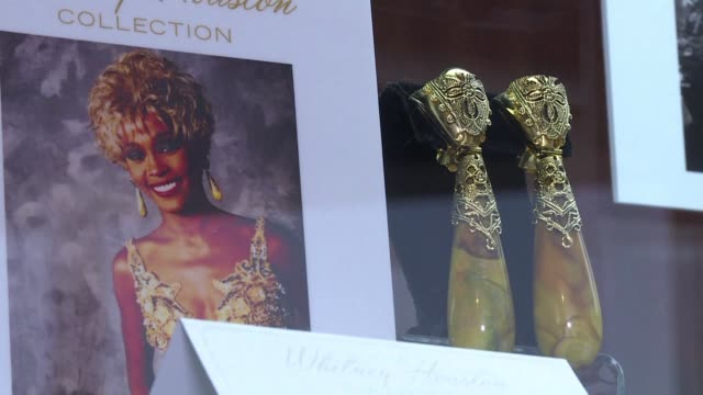 a collection of articles owned by late american singer whitney houston including a guitar from prince and a lock of david bowies hair will be... - whitney houston stock-videos und b-roll-filmmaterial