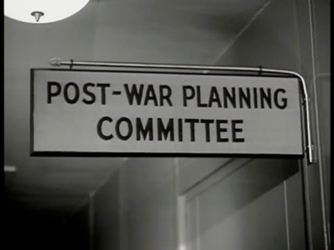 collection of booklets on postwar merchant marines cover of 'postwar program' sign postwar planning committee vice admiral emory s land sot saying... - axis powers stock videos & royalty-free footage