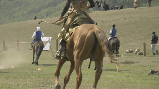 collection of clips from the horseback archery competition at the world nomad games 2018 - nomadic people stock videos & royalty-free footage
