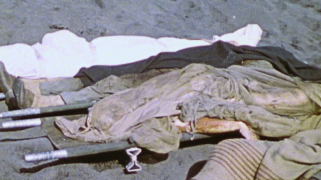 collection of corpses laying side by side and covered with bloody limbs hanging out from the covering / iwo jima, japan - iwo jima island stock videos & royalty-free footage