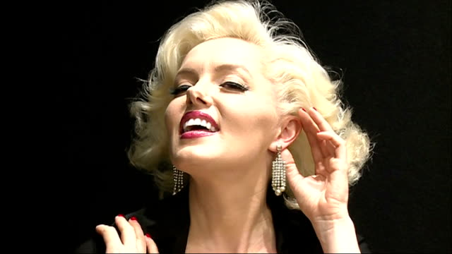 collection of david gainsborough roberts exhibited at christie's marilyn monroe lookalike posing with earrings / general views of exhibition - doppelgänger stock-videos und b-roll-filmmaterial