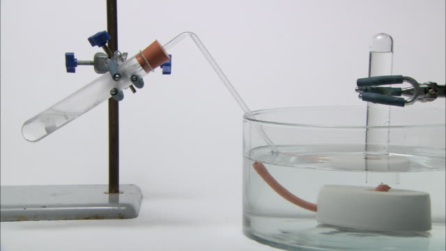 collection of hydrogen gas. the gas is produced by the reaction of magnesium and hydrochloric acid in the test tube at left. the gas is passed through a tube to a water-filled test tube, where it is collected - hydrochloric acid stock videos and b-roll footage