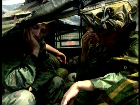 Collection T09089501 9895 Serbian soldier surrender their weapons Krajina Topusko Close shot of Serb soldier sitting in lorry dejected with head in...