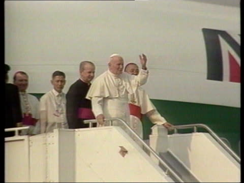 collection t12019504 1211995 pope john paul ii visits the philippines plane carrying pope john paul ii taxiing on runway group of brightly coloured... - pope john paul ii stock videos and b-roll footage