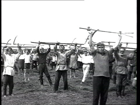 Collective workers and training Everyday life in a kolkhoz harvestmen carrying scythes and sickles peasants exercising w/ tools before harvesting...