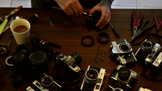 collector hobbyist cleaning vintage analog cameras time lapse - hobbies stock videos & royalty-free footage