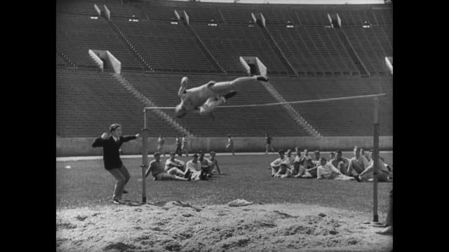 1927 A college athlete completes the high jump