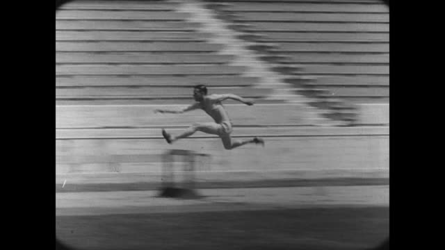 1927 A college athlete jumps hurdles