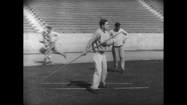 1927 a college athlete throws the javelin - javelin stock videos & royalty-free footage
