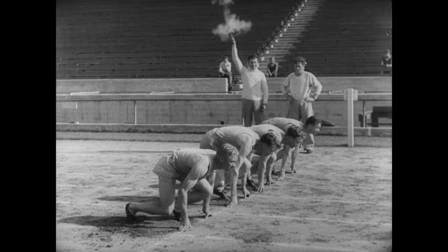 1927 college athletes practice track and field - atletico video stock e b–roll