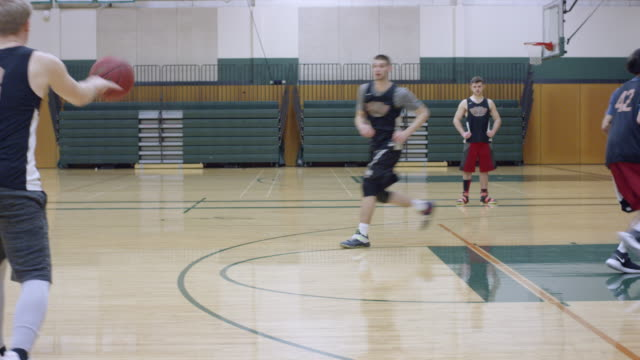 College Basketball Team Practicing Offensive Drill