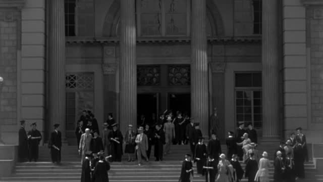 college graduates, parents and professors exit a college building. - 1938 stock videos & royalty-free footage