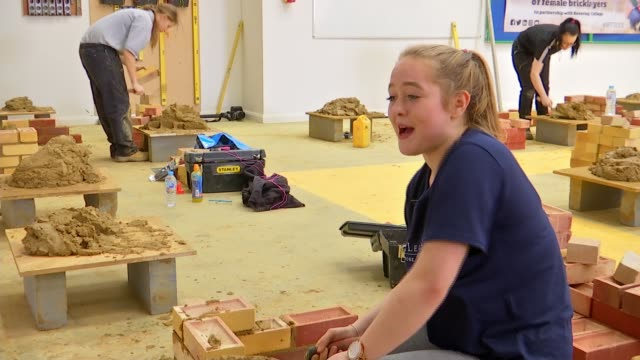 college hosting uk's first all-female bricklaying competition; uk, london, rainham; various shots of women competing in first ever all-female... - wet wet wet stock videos & royalty-free footage