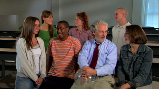 college students and professor in classroom - lecturer stock videos and b-roll footage