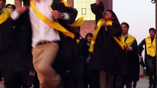 stockvideo's en b-roll-footage met college students celebrating graduation day in the college  - mortelplank