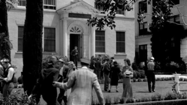 college students cross a college campus. - 1938 stock videos & royalty-free footage