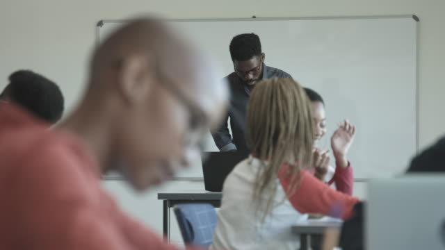 college students in classroom, close up - completely bald stock videos & royalty-free footage