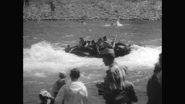 college students in makeshift boats compete in the oregon white water parade on the mackenzie river / crowd watches from the riverbank as the... - reifenschlauch stock-videos und b-roll-filmmaterial