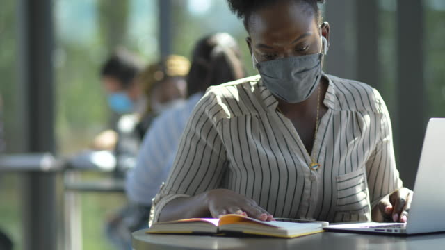 college students in protective face masks - back to school stock videos & royalty-free footage