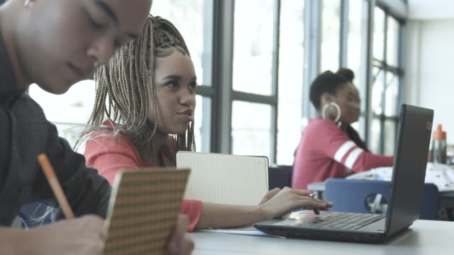 college students in study hall, close up - concentration stock videos & royalty-free footage