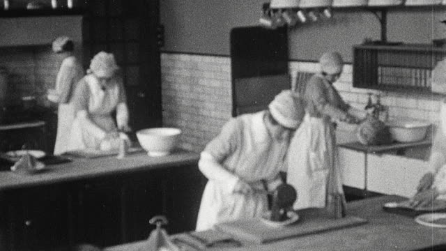stockvideo's en b-roll-footage met 1925 montage college students in various classes engaging in cooking, dress making, needlework, and furniture upholstery / newcastle upon tyne, england, united kingdom - 1920