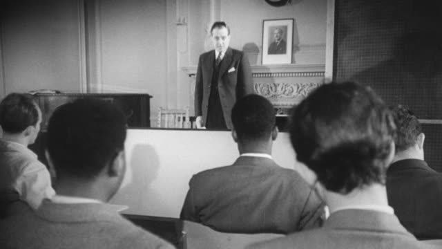 vidéos et rushes de 1948 montage college students listening and taking notes as professors are lecturing / nottinghamshire, england, united kingdom - professor