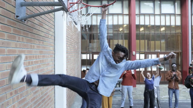 college students play basketball on campus, tracking shot - at the edge of stock videos & royalty-free footage