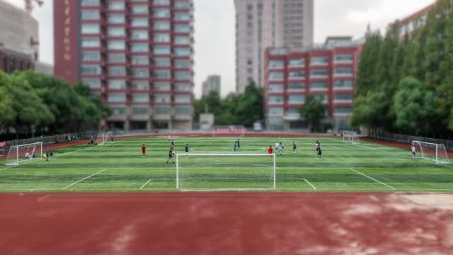 college students playing soccer on the soccer field - organised group stock videos & royalty-free footage