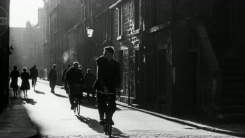 vidéos et rushes de montage college students riding bicycles in alley, student removing bike from rack and riding off, students in academic gowns entering university / st. andrews, scotland, united kingdom - 1948