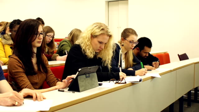 dolly hd, college students using digital tablet in lecture hall - seminar stock videos and b-roll footage