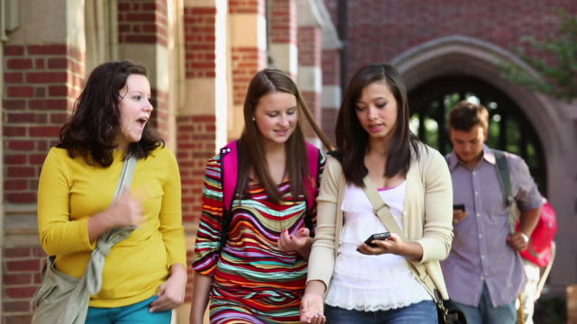 ms ts college students walking and talking on campus, using cell phones / richmond, virginia, usa - female high school student stock videos and b-roll footage