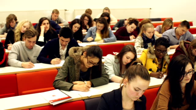 HD CRANE: College Students writing in University lecture Hall