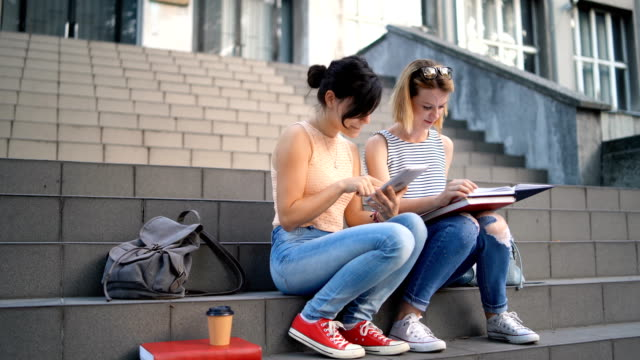 college women using tablet - electronic book stock videos & royalty-free footage