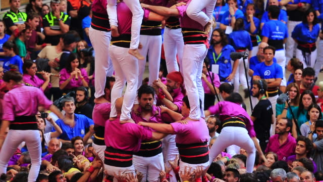 colles de castellers are building different castells, are tall human towers during the bianual concurs de castells competitions in tarragona. - organised group stock videos & royalty-free footage