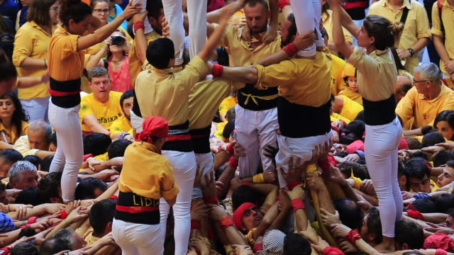 colles de castellers are building different castells are tall human towers during the bianual concurs de castells competitions in tarragona - human limb stock videos & royalty-free footage
