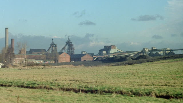 montage collieries occupying the countryside / nottinghamshire, england, united kingdom - kohlengrube stock-videos und b-roll-filmmaterial