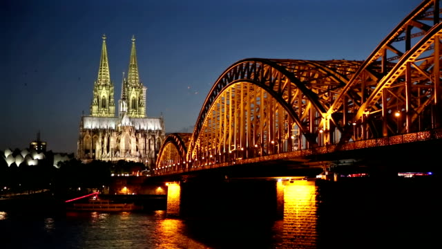 cologne cathedral and hohenzollern bridge at dusk germany - gothic stock videos & royalty-free footage