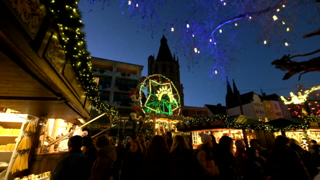 footage of Tourists walk around Christmas Market in Cologne at Heumarkt on December 2 2015 Cologne Christmas market or 'Weihnachstsmarkt' is the one...