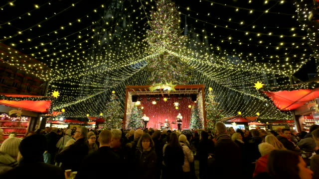footage of Tourists walk around Christmas Market in Cologne at Cologne Cathedral Place on December 2 2015 Cologne Christmas market or...