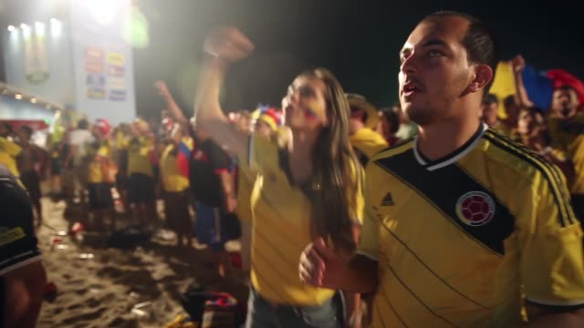 PAN Colombia fans celebrate a victory at the FIFA Fan Fest on Copacabanaa Beach on June 24 2014 in Rio de Janeiro Brazil