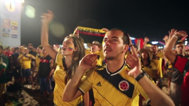 ms colombia fans celebrate a victory at the fifa fan fest on copacabanaa beach on june 24 2014 in rio de janeiro brazil - fan enthusiast stock videos & royalty-free footage