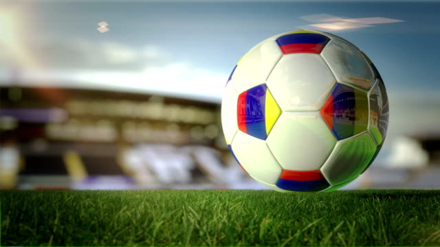 colombian ball turn at stadium - loopable - colombian flag stock videos and b-roll footage