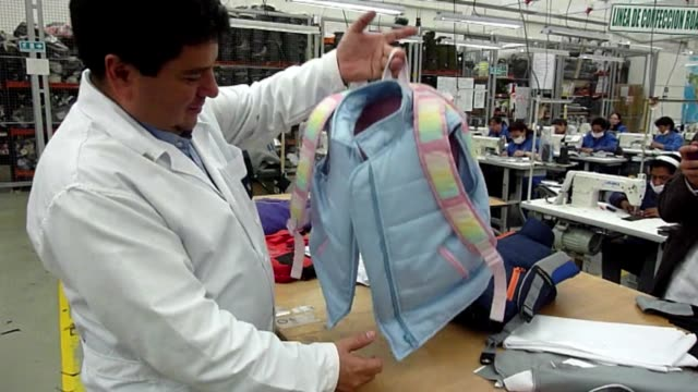 vídeos de stock, filmes e b-roll de colombian businessman miguel caballero has made bulletproof clothing for armies around the world for 20 years now he making childrenswear clean child... - à prova de balas