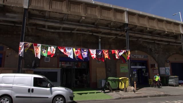 colombian cafes and shops in elephant and castle england london elephant and castle ext flags / train station sign / england football team flag / bar... - colombian flag stock videos and b-roll footage