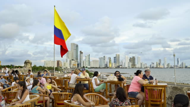 colombian flag at cafe del mar with skyline of new district bocagrande - colombian flag stock videos and b-roll footage