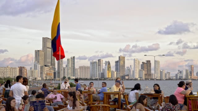 colombian flag at cafe del mar with skyline of new district bocagrande - colombia stock videos & royalty-free footage